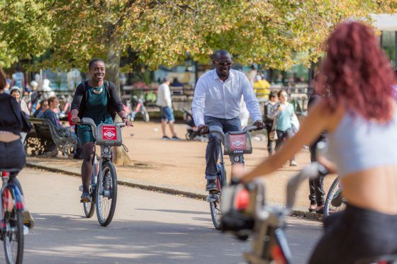 Woman and man cycling in Hyde Park