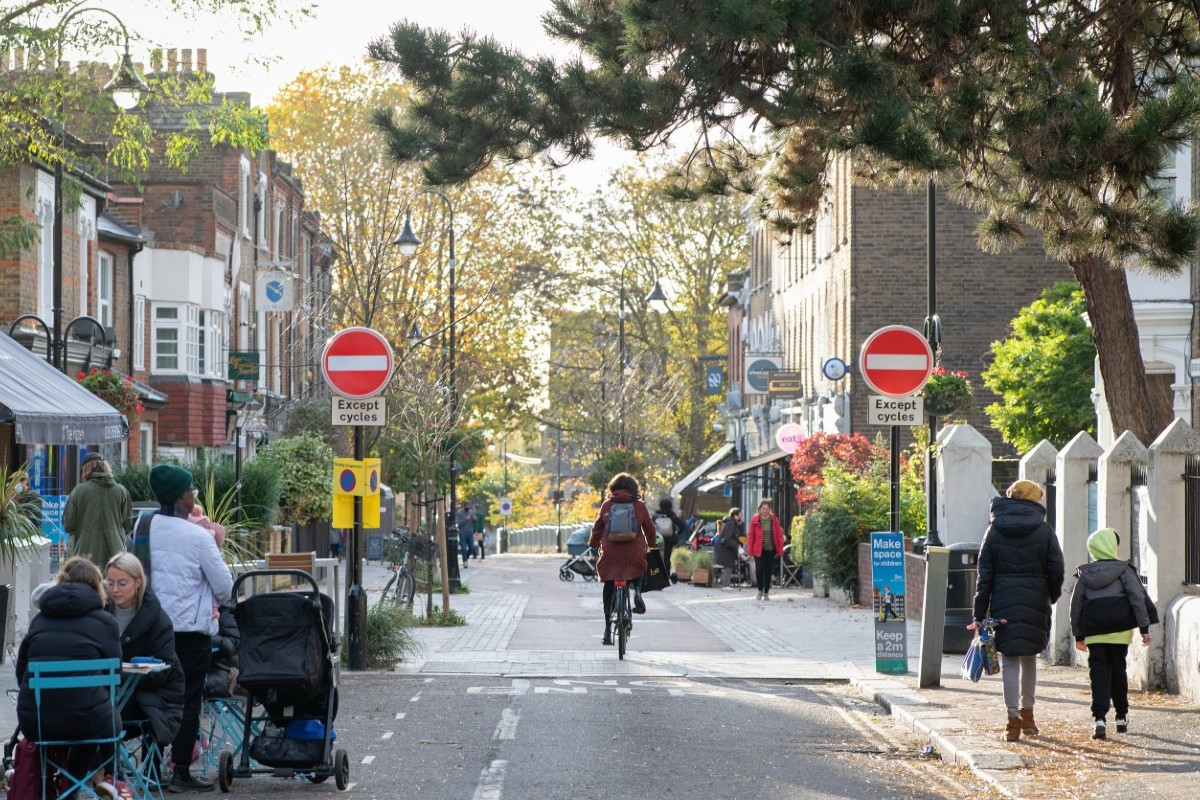 Woman cycling down a Low Traffic Neighbourhood street
