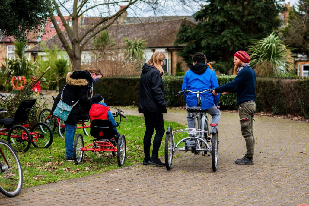 Boys on their adapted cycles in Hounslow's Inwood Park