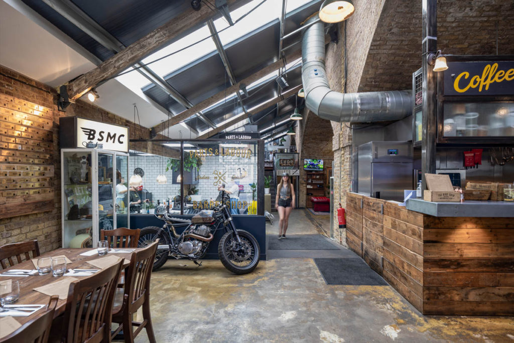 Inside a coffee shop and barbers in one of the arch properties.