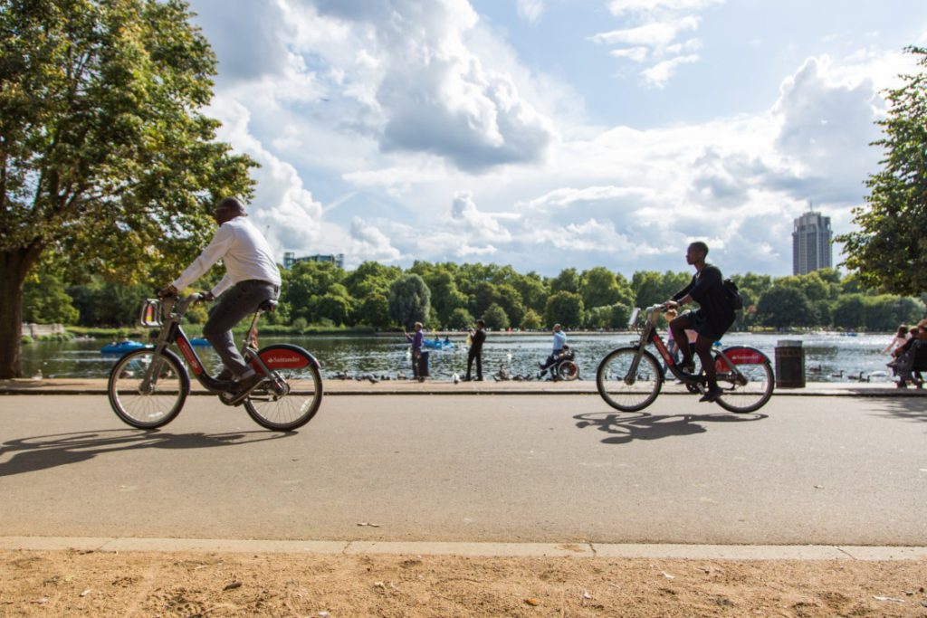 Commuters cycling with Santander Cycles in Hyde Park