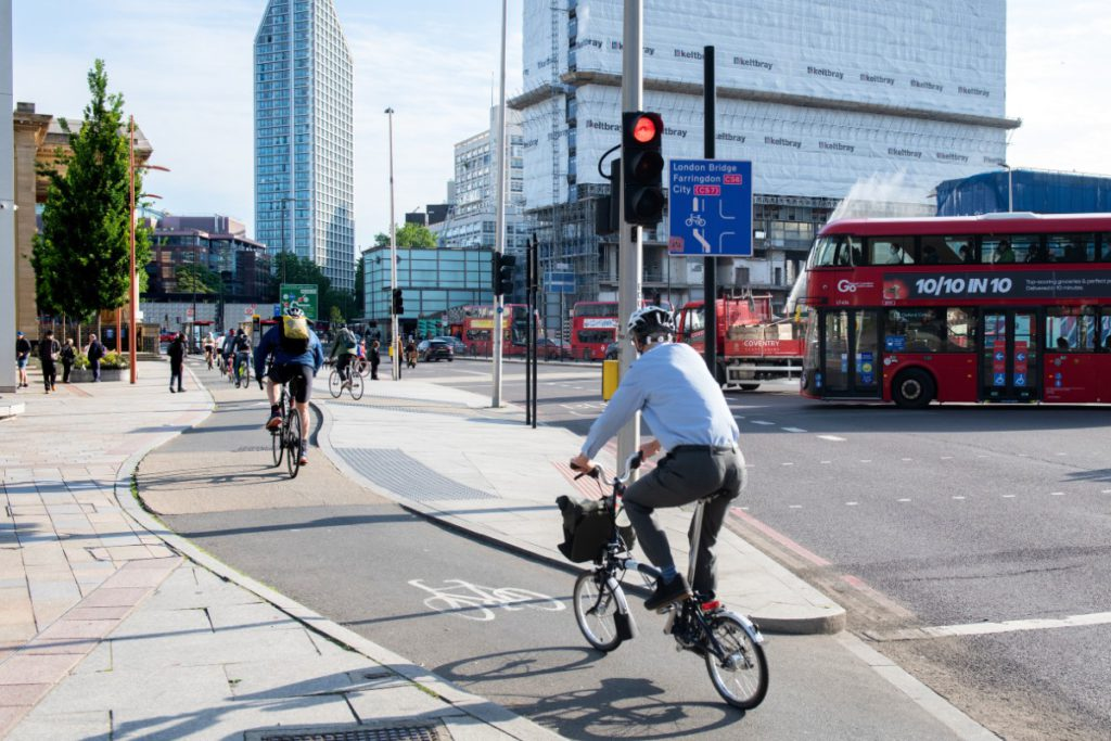 Commuters cycling in a cycle lane