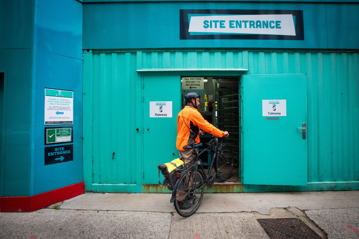 Person on a cycle entering the site entrance at work