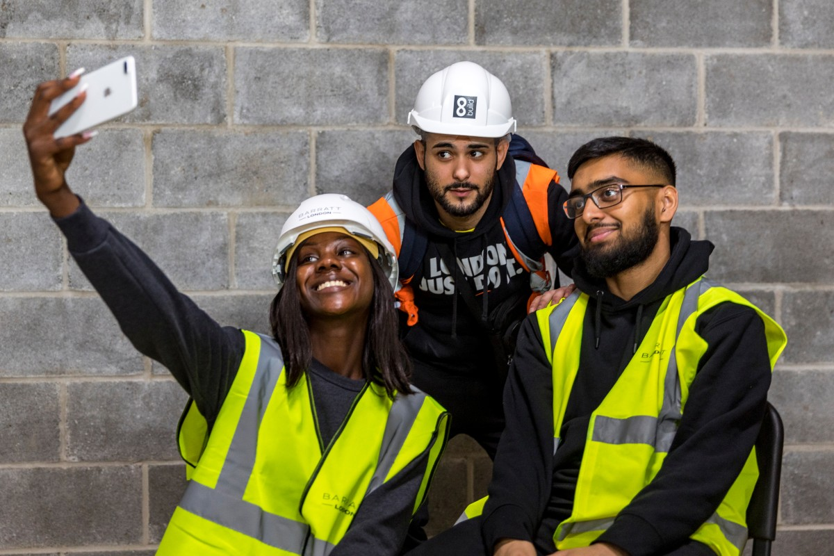 Group of three construction trainees taking a selfie