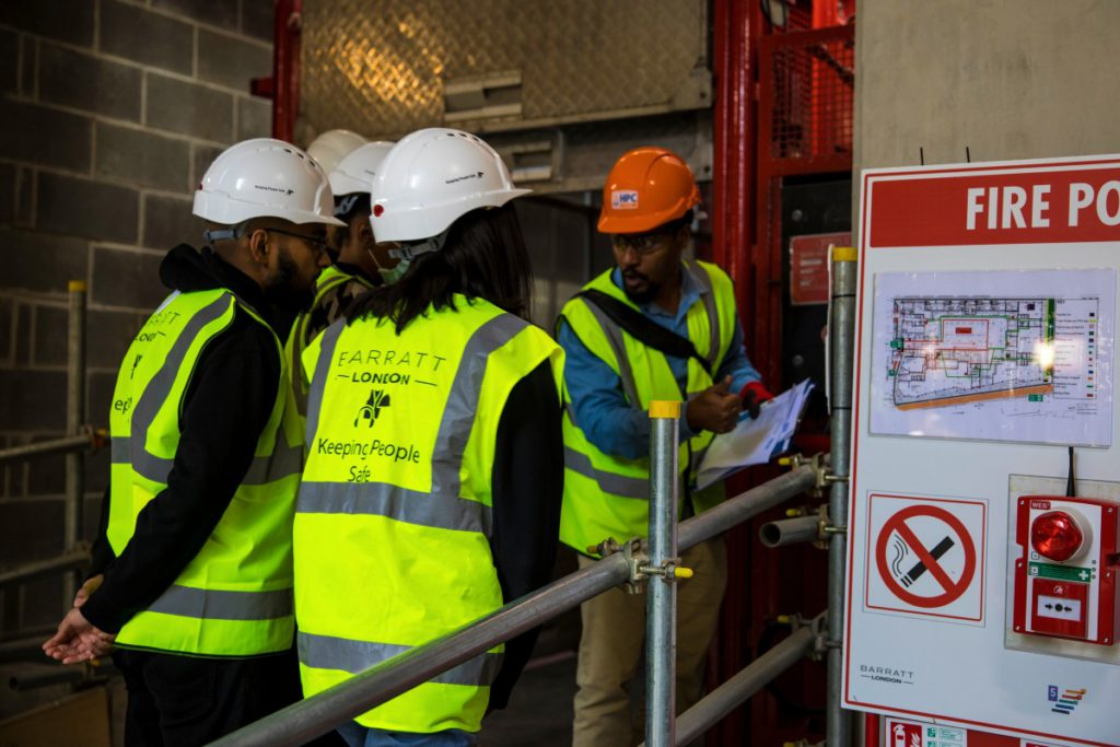 Construction trainees learning from an instructor