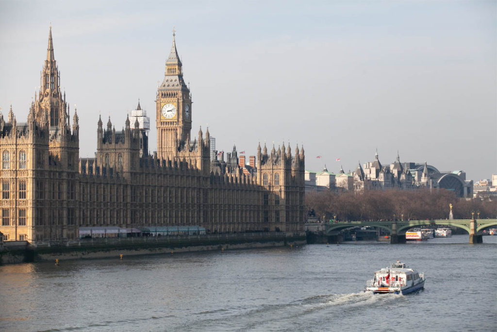 Boat going past the Houses of Parliament